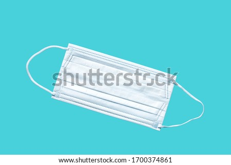 Medical mask, Medical protective mask on blue background. Disposable surgical face mask cover the mouth and nose. Healthcare and medical concept. #1700374861