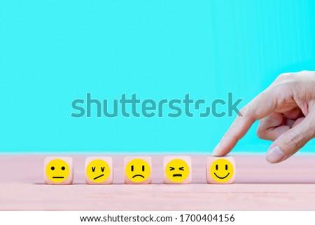 Businessman chooses a happy emoticon icons face.  Service, communication concept #1700404156