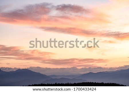 A Beautiful Aerial Photo of Japan's North Alps under Twilight Sunset Cloudy Sky Viewed from the Top of Takabotchi Plateau in Nagano, Japan.  #1700433424