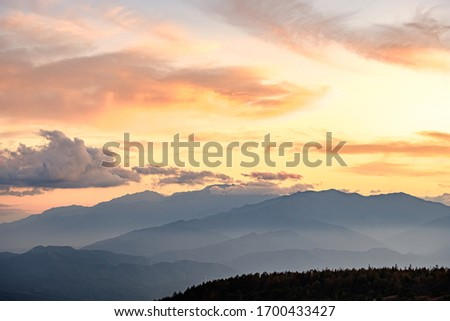 A Beautiful Aerial Photo of Japan's North Alps under Twilight Sunset Cloudy Sky Viewed from the Top of Takabotchi Plateau in Nagano, Japan.  #1700433427