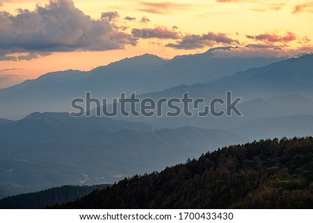 A Beautiful Aerial Photo of Japan's North Alps under Twilight Sunset Cloudy Sky Viewed from the Top of Takabotchi Plateau in Nagano, Japan.  #1700433430
