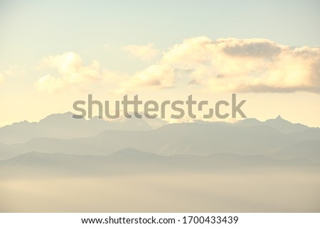 A Beautiful Aerial Photo of Japan's North Alps under Twilight Sunset Cloudy Sky Viewed from the Top of Takabotchi Plateau in Nagano, Japan.  #1700433439