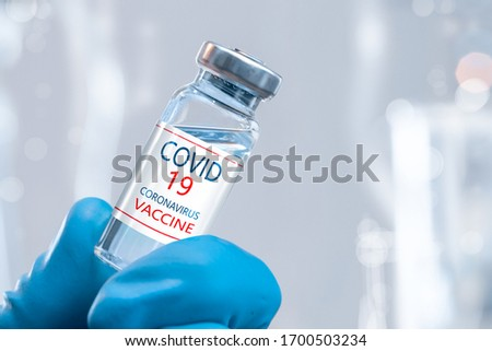 Development and creation of a coronavirus vaccine COVID-19 .Coronavirus Vaccine concept in hand of doctor blue vaccine jar. Vaccine Concept of fight against coronavirus. #1700503234