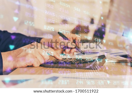 Financial trading graph multi exposure with man desktop background. #1700511922