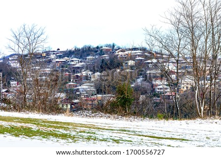 Kutaisi, Georgia-April 2020: Kutaisi city with residence in the winter from mountain of the Bagrati Cathedral. Travel destination. #1700556727