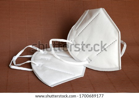 white KN95 or N95 mask for protection pm 2.5 and corona virus. Prevention of the spread of virus and pandemic COVID-19. #1700689177