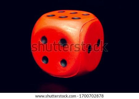 Big dice of red color on a black background #1700702878