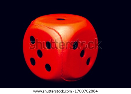 Big dice of red color on a black background #1700702884