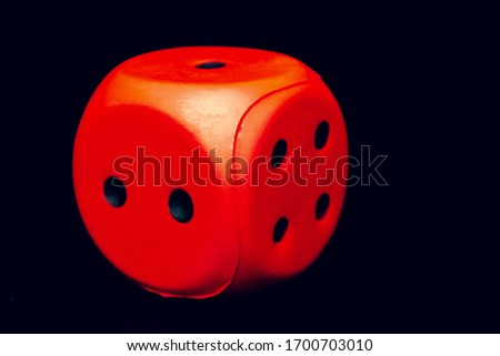 Big dice of red color on a black background #1700703010