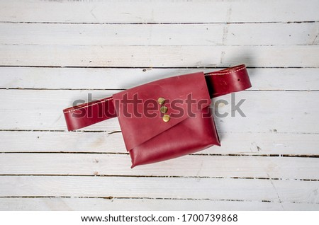 brown leather belt bag on a white background  #1700739868