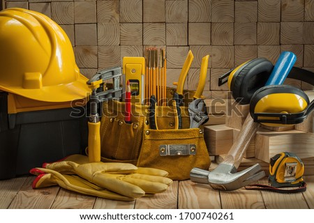 big set of construction carpentry tools on wooden background Royalty-Free Stock Photo #1700740261