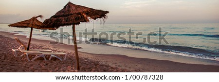 Beach umbrellas near the sea vintage photo. Summer banner