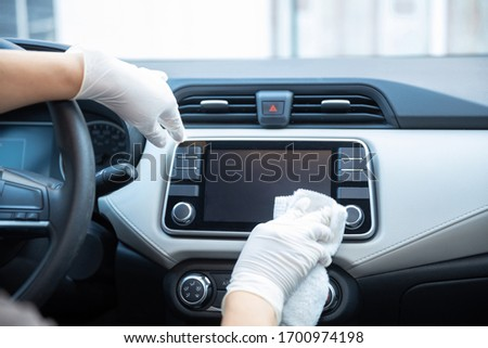 gloved hands cleaning a car due to coronavirus pandemic in mexic #1700974198