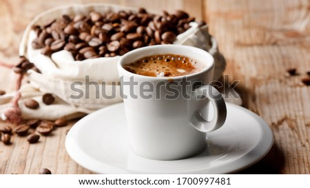 cup of coffee with beans #1700997481