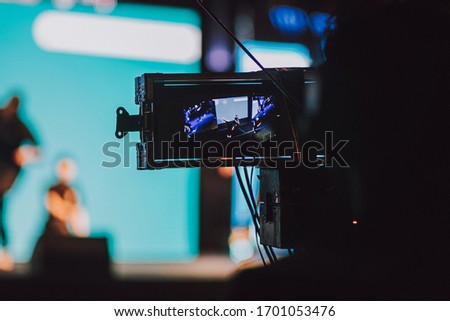 Video operator filming an event on the stage Royalty-Free Stock Photo #1701053476
