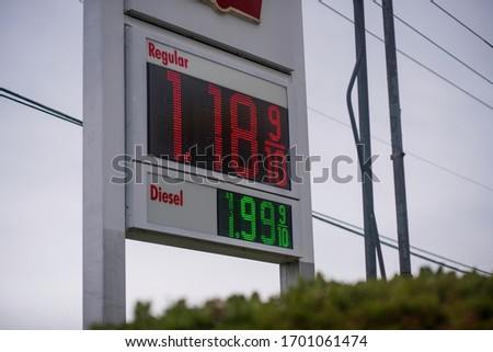 digital sign showing cheap gas prices