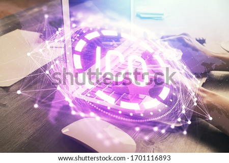 Double exposure of woman hands typing on computer and crypto market theme hologram drawing. Blockchain concept. #1701116893