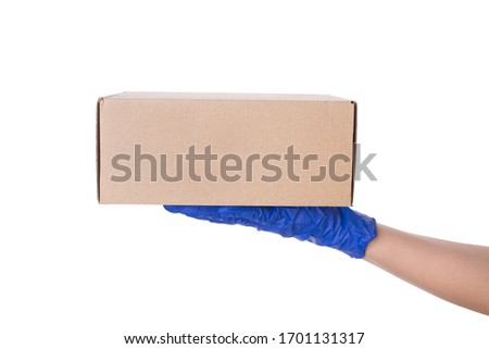 Safe delivery concept. Side profile close up photo of hand holding carton craft paper parcel isolated over white background with empty space #1701131317