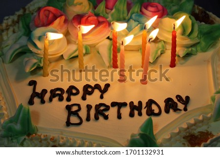 Image of cake with candles, happy birthday.