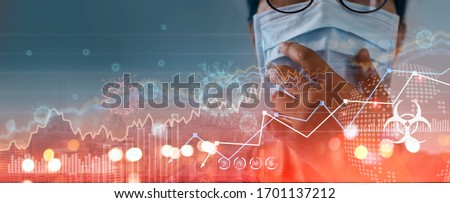 Businessman wearing virus mask, Analysis corona virus economic impact,  crisis and economic and financial conditions in the global due sinks stock exchanges, Effects of outbreak and pandemic covid-19 Royalty-Free Stock Photo #1701137212