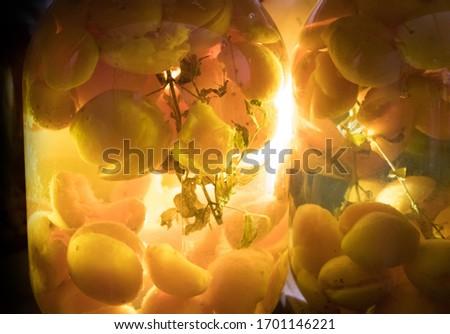 A closeup shot of apricot compote in big glass jars #1701146221
