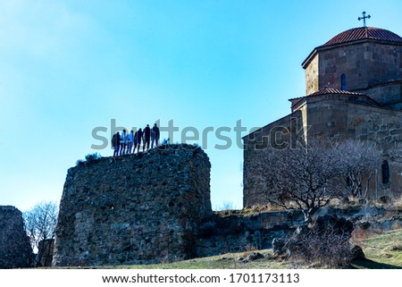 Tourists destination in Jvari Monastery exterior fragment build in sixth-century. Georgian Orthodox monastery located on the mountain peak between Tbilisi and Mtskheta, Georgia #1701173113