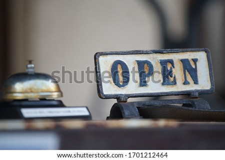 The metal signboard which was rusted of the letter of the open                                #1701212464