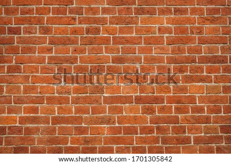 brick red wall. background of a old brick house. #1701305842