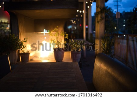 Sherman Oaks, California/USA - April 4th 2020: At 5:59 PM on a Saturday night, due to the Coronavirus and stay at home order, there is an empty booth in the outdoor seating area of this restaurant. #1701316492