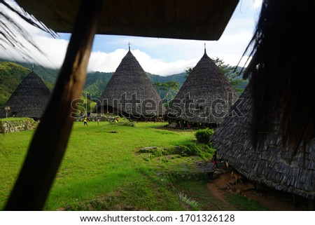 The traditional houses of wae rebo people called mbaru niang located in the mountaint, need to forest tracking to reach it #1701326128