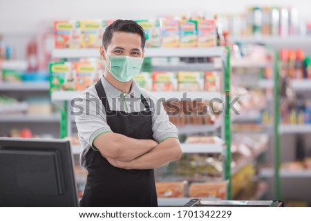 portrait of happy asian male shopkeeper #1701342229