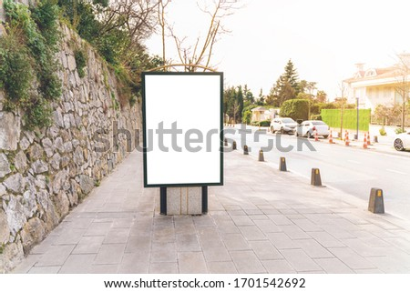 Blank mock up of vertical with copy space area for your text message or promotional content next to road in day. City  Istanbul in Turkey