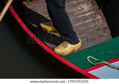 Man wearing Dutch clogs at the Alkmaar cheese market, Netherlands #1701592501