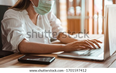 Woman work from home wearing mask protection wait for epidemic situation to improve soon at home. Coronavirus, covid-19, Work from home (WFH), Social distancing, Quarantine, Prevent infection concept. #1701597412
