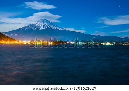 Japan. Mount Fuji in autumn evening. City lights at foot of the volcano. Lake Kawaguchiko the backdrop of Fujiyama. Landscape of lake Kawaguchiko. Top of Mount Fujiyama in the snow. Sights Japan #1701621829