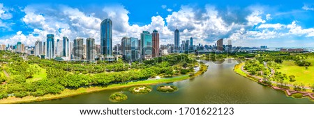 Haikou City Skyline in the Binhai Avenue Central Business District with Office Buildings and Evergreen Park View, Hainan Province, The Largest Pilot Free Trade Zone in China, Asia. Panorama View. #1701622123