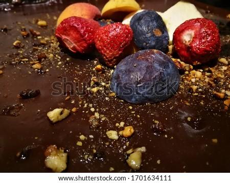 Chocolate cake with fresh fruits. Macro Pic of dessert.
