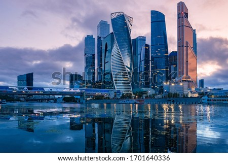 Russia. Skyscrapers in the center of Moscow. High-rise buildings in the capital of the Russia. Complex Moscow-city against the gray sky. Skyscrapers and a glazed bridge over the Moscow river. #1701640336