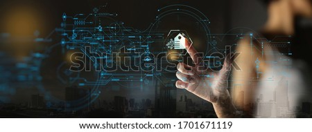 Businesswoman Hand pushing Smart home Automation Control System Ui with Innovation technology internet Network,Working remotely from home concept. Royalty-Free Stock Photo #1701671119