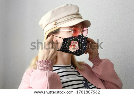 Young woman wearing handmade stylish cloth cotton face mask as decorative accessory element. Popular trend in fashion industry. Reusable face mask. #1701807562