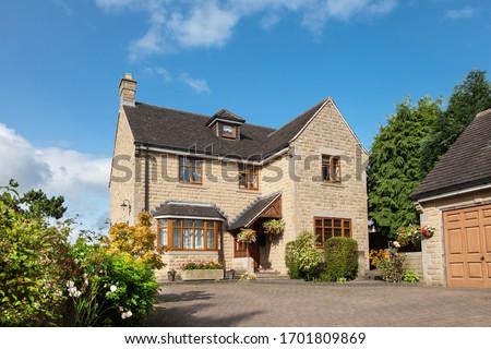Front of elegant english detached house Royalty-Free Stock Photo #1701809869