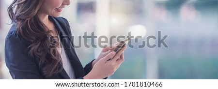 Successful businesswoman using smart phone, banner with space for text. Royalty-Free Stock Photo #1701810466