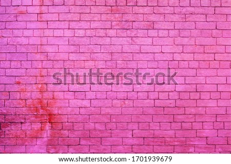 Pink painted brick wall with stain. #1701939679