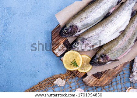 Raw uncooked trout with lemon and spices #1701954850