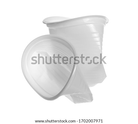 Disposable crumpled, plastic cup  for throwing away and recycling isolated on white background with clipping path #1702007971