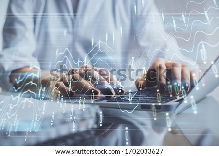 Double exposure of woman hands typing on computer and forex chart hologram drawing. Stock market invest concept. #1702033627