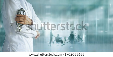 Healthcare and medical concept. Medicine doctor with stethoscope in hand and Patients come to the hospital background. #1702083688