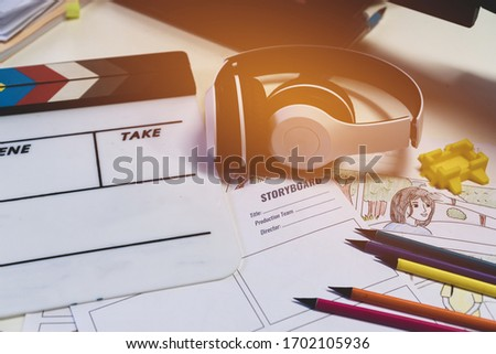 Storyboard Video for Pre-production on film movie concept: Color pencil drawing on sketch board carton template with headphone on slate, Behind process design creative scene in studio