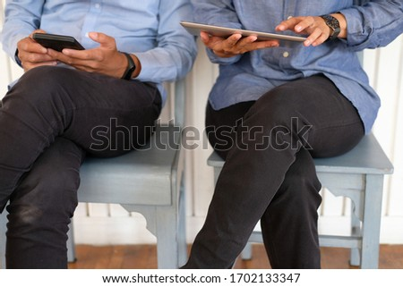 business people discussing using tablet smart mobile phone at workplace #1702133347