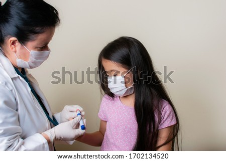Beautiful Colombian girl is examined by her pediatrician in the consulting room #1702134520